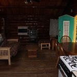 Living, dining, kitchen area of cabin from other side. Bathroom (not pictured) to left