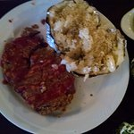 Meatloaf, baked potato, overcooked mixed vegies