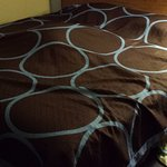 This was how the made the bed- threw the quilt over a huge mess and called it a day!