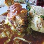 Pork knuckle with bacon dumplings & gravy