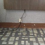 no baseboards & cords running across floor