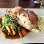 Roast half chicken dish with spring onion mash, honey glazed carrots and jus. 5* food!