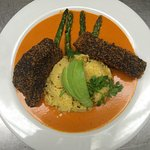 Baby shark with poppy seeds and red pepper sauce