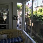 Plenty of room in this enclosed porch for four people in the early morning or late afternoon