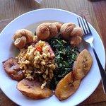 Ackee and salt fish, callaloo, johnny-cakes and plantain.