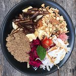 Fruit salad bowl with added dates and ground flaxseeds