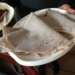 My favorite dishes at massawa.  Coconut sorbet, shiro, and injera.