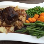 Braised Lamb on a bed of mash with onion gravy