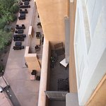 Balcony below us where a group of people sat drinking loudly all night, with no action by front