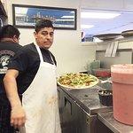 Chef Javier Acosta Preparing Pizza