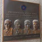 Commemorative plaque remembering presidential visits.