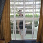 This is me imitating people as they walk by, looking into our room.