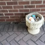 Trash filled ash tray near front entrance
