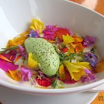 White Gazpacho with edible flowers.