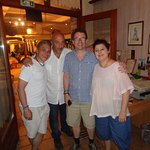 My husband and I with owner Litsa and host Georgios.