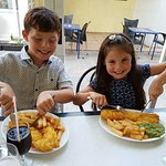 The kids enjoying their fish & chip!