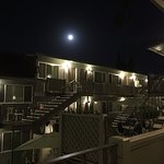 Sitting on my balcony in the warm air and moonlight.