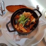 Cioppino (bouillabaisse). A delectable medley of salmon, crab, shrimp, mussels and scallops.