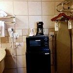 "Sink, hairdryer, fridge, microwave, coffeemaker, ""closet,"" ironing board."