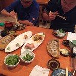 Colleagues enjoying their Sushi and Gyoza