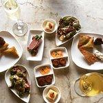 Club level hors d'oeuvres - crab cakes, samosa, ham, artichoke salad