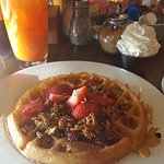 My Breakfast. = Day Glo Juice with Belgian Waffle&whipped cream(my sausage links came separate)