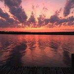 Sunrise, pool, and pier