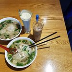 Bowl of chicken and beef pho, avocado smoothie and vietnamese coffee.