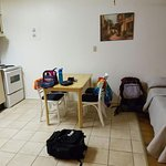 Joined kitchen and living room doubles as second bedroom with two double beds and a futon.