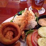 Up in Smoke burger with melted pepper jack cheese and crunchy onion rings