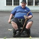 me in wheel chair outsde smoking area[parking lot]