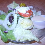 Greek salad that comes with Greek sampler
