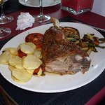 Succulent lamb well seasoned and cooked to perfection. Saute Potatoes and vegetables.