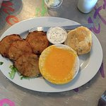 Sides of fried green tomatoes, grits and a biscuit