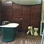 Outdoor tub on the private deck of the premier garden room