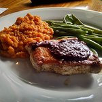 Carolina Heritage Farms pastured raised pork with Blackberry Barbecue, over Sweet Potato Puree a
