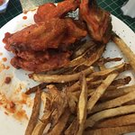 Hot wings & fresh cut fries and gator tail w/bacon as an appetizer