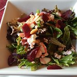 Beet and Goat Cheese Salad with Greens, Almonds, and Raspberry Dressing