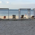 Great beach to enjoy the view and sunset but limited chairs...