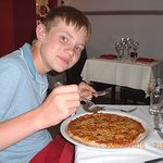 Grandson with his pizza... nothing left on plate !!!!