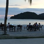 Diners having a romantic diner on the beach