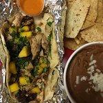 Brushfire taco: Jamaican jerk chicken,jalapeño,mango&cilantro w/diablo hot sauce on flour tortil