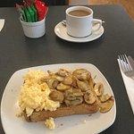 Scrambled eggs and mushrooms on toast.