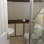 Sloping roof in tiny bathroom - expect to bang your head!