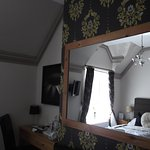 Large mirror opposite bed and small desk in Room 1 (Peony)
