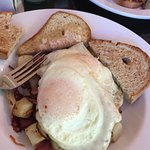Corned beef hash, two eggs, over easy and gluten free toast. Amazing!