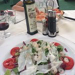 Seafood salad, chianti and pizza margerita