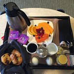 The Continental breakfast--fruit, muffins, eggs, yogurt, juice and coffee