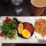 Unique breakfast: soft eggs encrusted and served with arugula and root hash browns