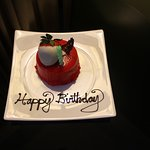 The birthday cake sent by the hotel. It s a red velvet cake. Yummy!